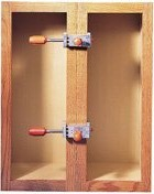 Clamped cabinet