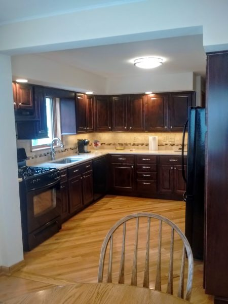 Grassi Project: Kitchen reface using CRP-10 doors in Maple with Bordeaux finish.