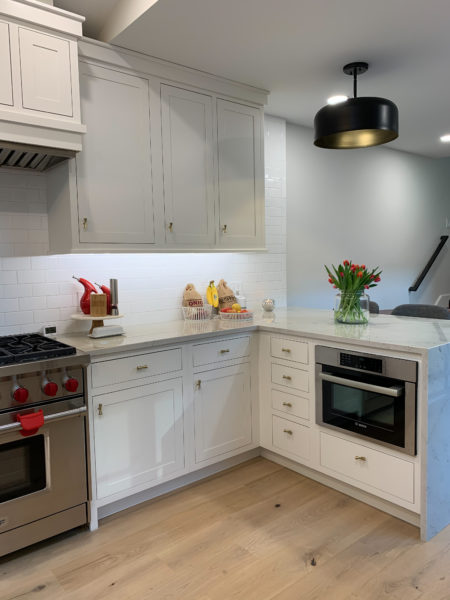 Flush Inset, Amesbury doors, Slab drawers, Crown 2 piece filler slab, & Frosty White finish